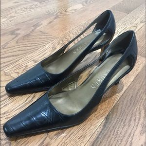 Black leather heels with cut outs